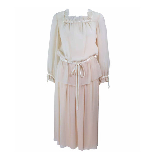 This Christian Dior Couture ensemble is composed of a raw silk chiffon in a natural nude hue. Features a peasant style blouse with ruffle and satin trim, there are side snap closures with hook and eyes. The skirt has a pleated style with side zipper closure.