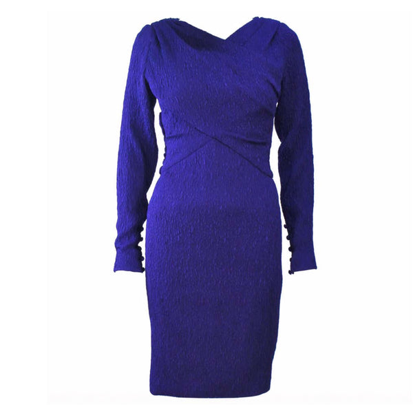 This Christian Dior purple silk dress dress features is draped and ruched with a side zipper closure, snaps, and hook & eyes. There is a boned interior.  In excellent condition.  Made in France.