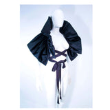 "ELIZABETH MASON COUTURE 'Avant Garde' Black Silk Wrap Made to Order.  This Elizabeth Mason Couture 'Avant Garde' wrap is composed of a black silk. This wrap can be made to order in a variety of fabrics. An effortlessly chic design for an added touch of exquisiteness, can be worn in a variety of ways. Made in Beverly Hills. The sample is available for purchase or please contact us for a custom order. Measurements of size:Length: 29.75"" Width: 17 3/8""Strap Length: 62 2/8"""