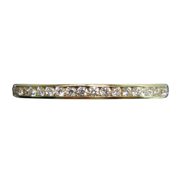 FRED 18 Karat Yellow Gold Diamond Eternity Band This Fred ring is composed of a yellow 18kt gold, and features an eternity pave design. Size 7. Please feel free to ask us any questions you may have.