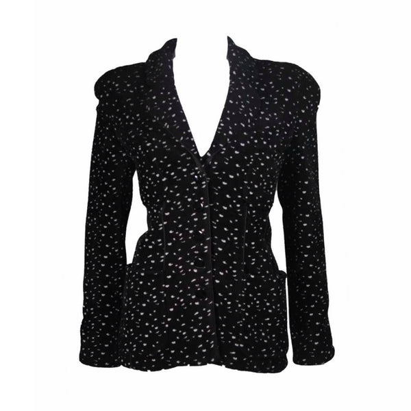 This Giorgio Armani jacket is composed of a wool blend in a black with white speckle textile print. There are front pockets, front button closures, and piping trim. In excellent condition. Made in Italy.