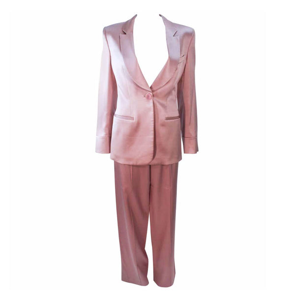GIORGIO ARMANI Pink Mauve Silk Pant Suit with Beaded Mesh Body Suit Size 42. This Giorgio Armani pant suit is composed of a pink mauve hue silk, comes with a brown beaded mesh bodysuit. The jacket has a center front button closure, and the pants feature a zipper closure. In excellent condition