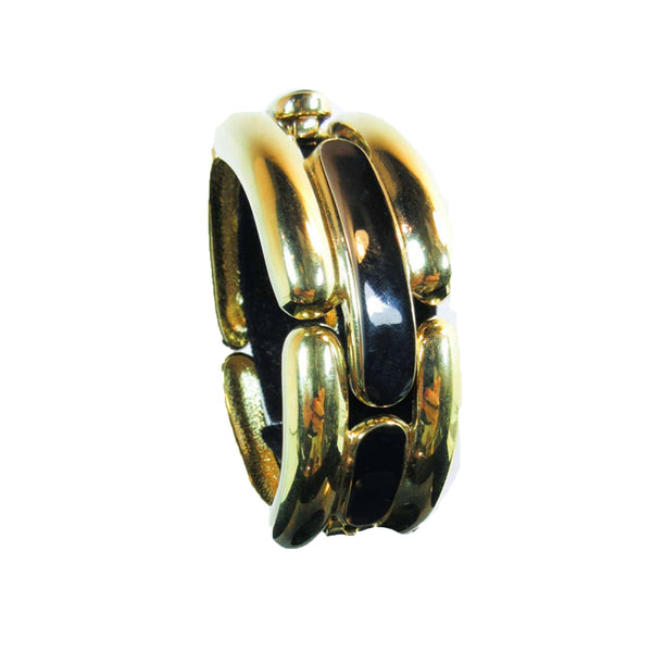 This vintage Givenchy bracelet is composed of a gold tone material and features black accents. Clasp closure. In excellent vintage condition (shows some signs of wear due to age).
