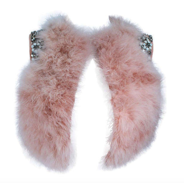 This Givenchy jacket is composed of a soft mauve pink marabou and features rhinestone jewel accents at the shoulders. The base is composed of silk and features a silk organza interior. In excellent condition.