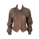 This Gucci jacket is composed of a supple khaki brown hue suede. Features center front button closures, and shoulder pads. In excellent vintage condition.