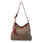 GUCCI Canvas Logo Hobo Style Purse with Tassel