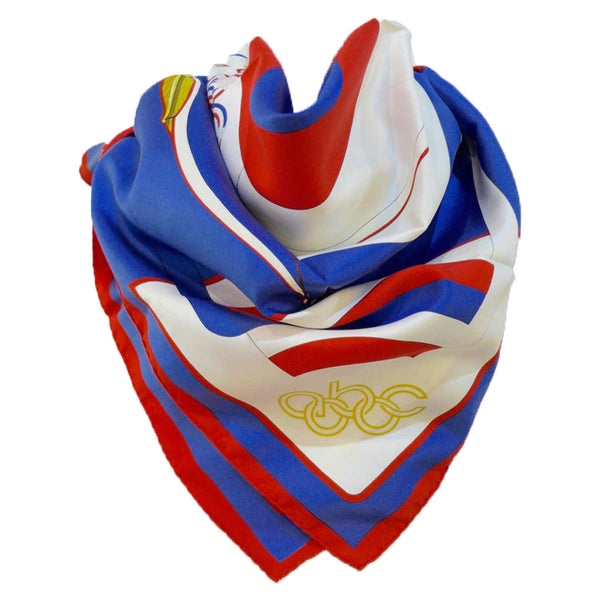 "HERMES 1984 Summer Olympics Silk Scarf. Made in France of pure silk and finished by hand with finely rolled hand-stitched edges, this eye-catching Hermès scarf is 36"" x 36"" in size and features a 1984 Summer Olympics ABC torch and rings design."