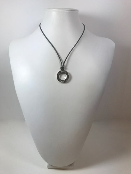 St. John Silver Tone Circle Pendant and Thin Leather Necklace