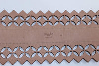 "ALAÏA Nude Wide Leather Laser Cut Belt Size Large. This Alaia belt is composed of a nude leather with a laser cut detailing. Features a center front adjustable buckle. In excellent pre-owned condition, slight signs of wear. **Please cross-reference measurements for personal accuracy. Size in description box is an estimation. Measures (Approximately) Marked size 80 Length: 31"" - 32"" Width: 4.75"""