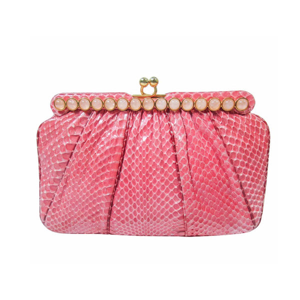 "JUDITH LEIBER Pink Snakeskin Clutch w/ Optional Strap Mirror Coin Purse . This Judith Leiber purse is composed of a pink snakeskin. Features a bar style frame with cabochon stone accents and gold hardware. There is an interior pocket and two slide pockets. In excellent 'like new' pre-owned condition (some signs of wear due to age, see photos). Sold ""AS-IS""."