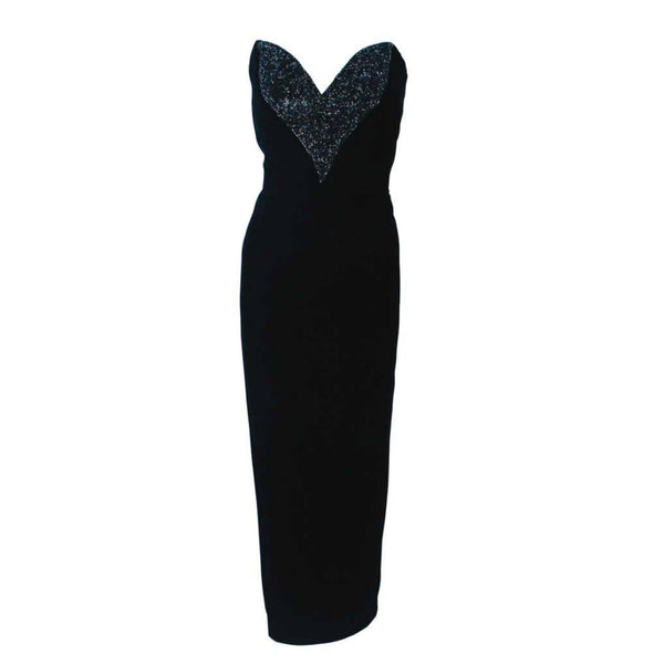 This Oleg Cassini Black Tie gown is composed of a black velvet. Features an absolutely stunning beaded bust with sweet heart neckline. Such an easy an simplistically chic design. There is a zipper closure. Made in USA.