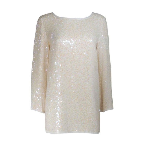 This Oleg Cassini tunic is composed of an off-white iridescent sequined silk. Features side slits with white beading embellishment, there is a center back zipper closure. In great vintage condition.