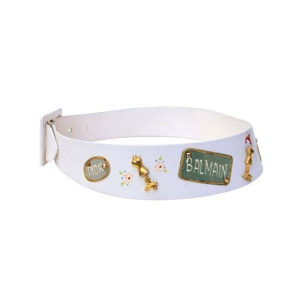 This is an adorable novelty belt that was made for Saks Fifth Avenue by Calderon. It is made of white leather and has designer names painted on it and metal dress form and rhinestone embellishments.