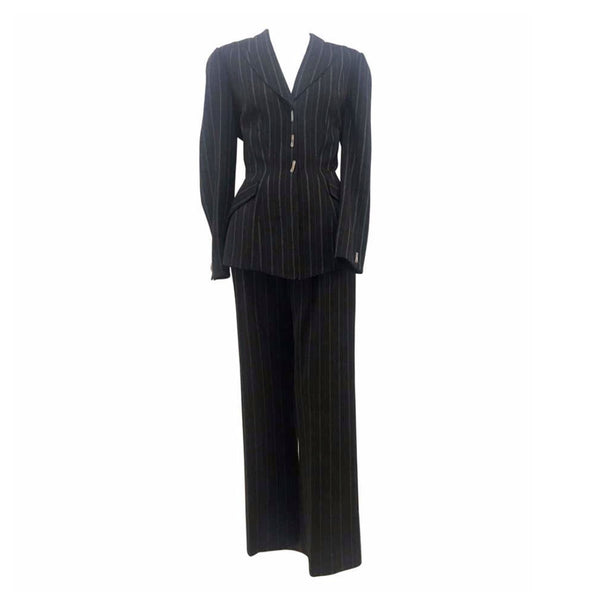 THIERRY MUGLER Black and White Stitched Pinstripe Pant Suit Size 40. This THIERRY MUGLER pant suit is composed of a wool pinstripe fabric. Features a classic Mugler silhouette with nipped waist and curved bust-line to neckline design. The jacket has front snap closures, rounded shoulders, and silver bar buttons. The classic pants features a zipper closure. In good vintage pre-owned condition. Made in France.Measurements in Inches:JacketBust: 40Waist: 32 PantsWaist: 27Hip: 40Length: 40Inseam: 29.5