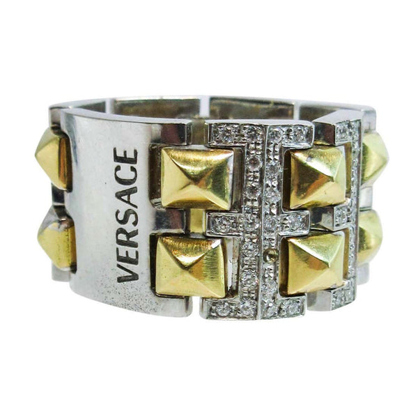 VERSACE 18 Karat White and Yellow Gold with Diamond Accents. This Versace design ring is composed of white and yellow gold, and features approximately 0.60cts of diamonds. Size 6. Please feel free to ask us any additional questions you may have.