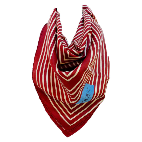 "Yves Saint Laurent Burgundy Striped Silk Scarf. Made in France of pure silk and finished by hand with finely rolled hand-stitched edges, this eye-catching YSL scarf is 35"" x 35"" in size and features a square stripe design and blue logo."
