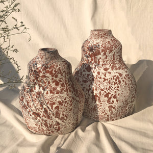 Off white clay vases