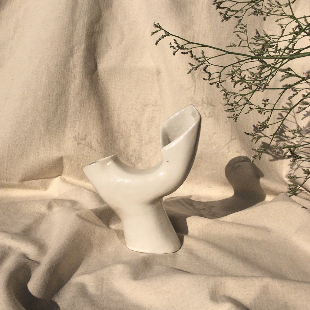 Milk glass culpture