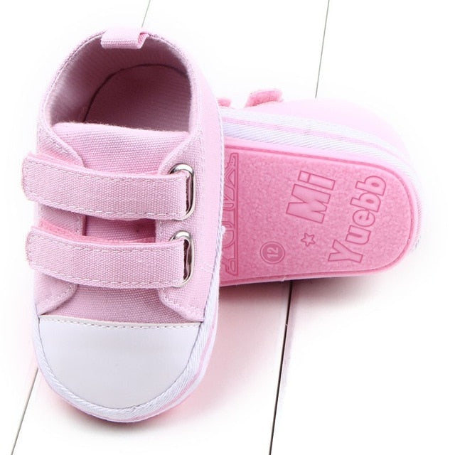Pink soft sole shoes with white toe. Baby tennis shoes
