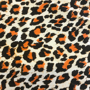 Stretch Black White & Orange Leopard Skin Lycra Fabric 1m