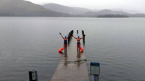BBC weather pictures two ladies swimming in a flooded derwent