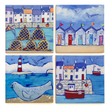 Set of 4 seaside ceramic coasters featuring colourful houses seals, fishing boats and beach huts.