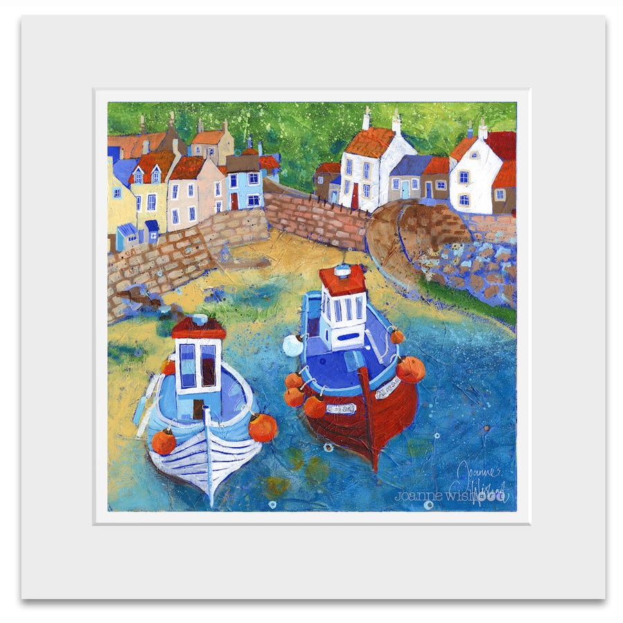 A mounted art print of fishing boats in Staithes harbour.
