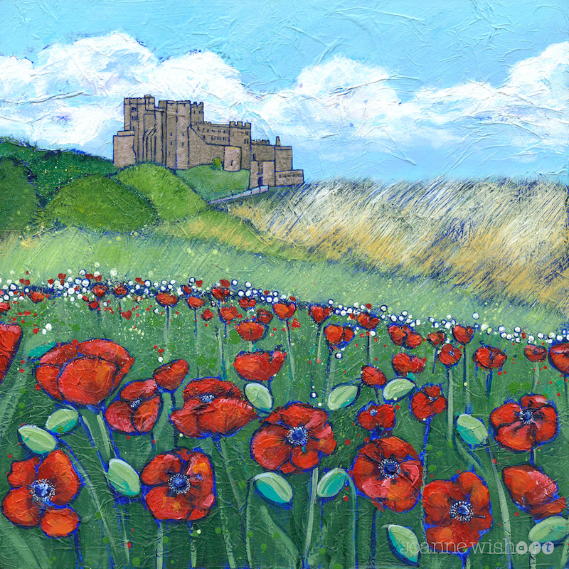 A print featuring a field of bright red poppies in front of Bamburgh Castle.