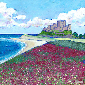 A print of the iconic bamburgh castle perched above a sweeping field of purple wildflowers.