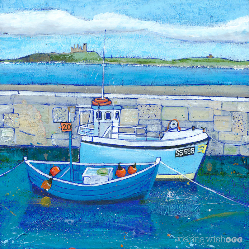 A fine art print of Beadnell harbour fishing boats with Dunstanburgh Castle in the distance.