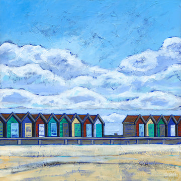 A fine art print of a row of colourful beach huts on Blyth beach.