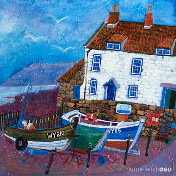 A charming fine art print of a fishermans cottage and coble boats at Robins hood Bay.
