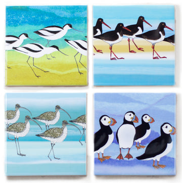 A set of 4 seabird ceramic coasters, featuring an avocet, oystercatcher, curlew and puffin.