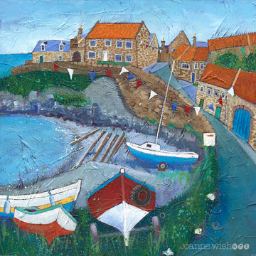 An uplifting print of Craster harbour in northumberland with boats and bunting bin the bay.