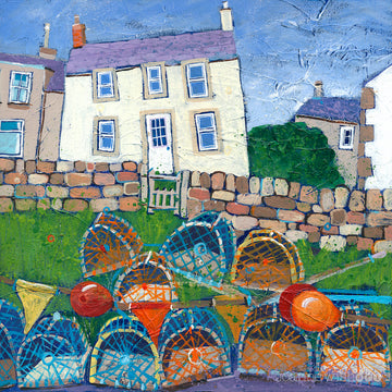 A print of a white fishermans cottage in Craster with a pile of lobster pots in the foreground.
