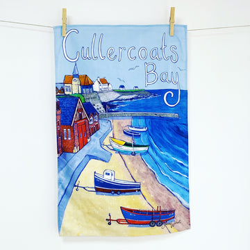 A tea towel of Cullercoast Bay.