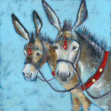 A print of two seaside donkeys bridled up with red accents on the leatherwork.
