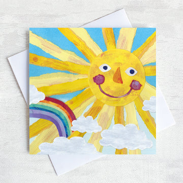 Greetings Card Featuring a smily faced sun and a rainbow.