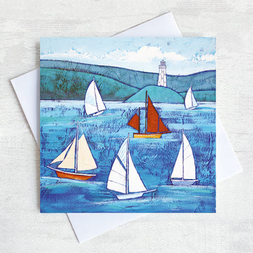 A cornish greetings card featuring sailing boats on a blue sea.