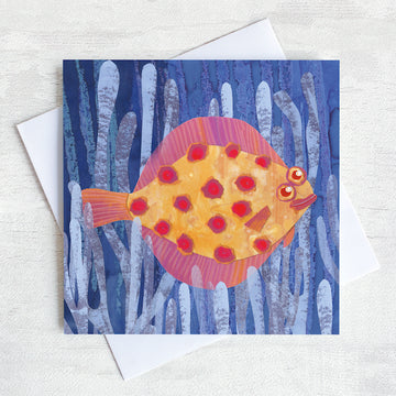 A quirky greetings card featuring a spotty plaice fish swimming through the sea weed.