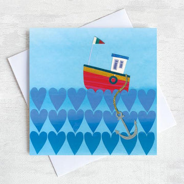 Valentines greetings card featuring a fishing boat on a sea of hearts