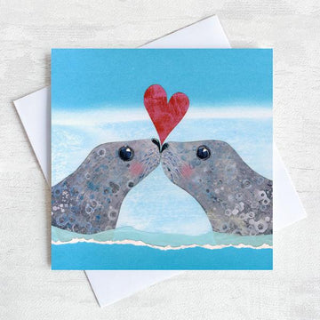 Seals kissing on a valentines greetings card