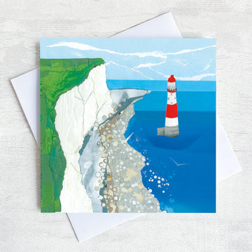 A coastal greetings card showing beachy head lighthouse as seen from a bird eye view.