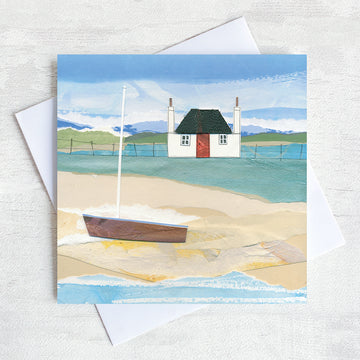 A scottish greetings card featuring a blackhouse cottage on a shore with a boat on the beach.
