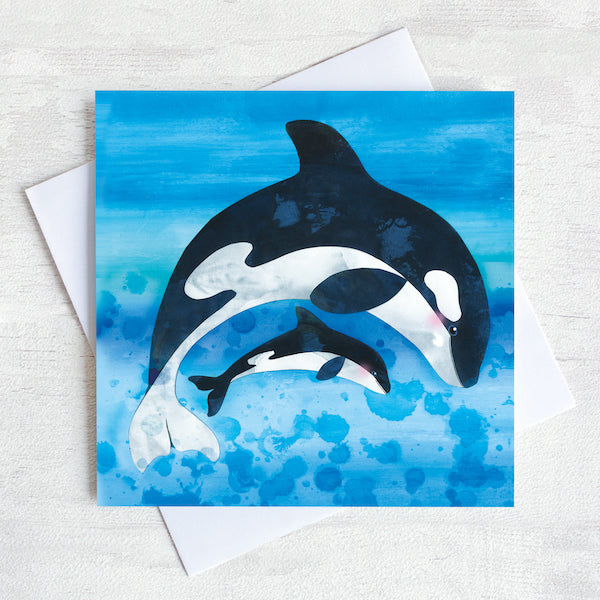 An ocean greetings card of and Orca and its pup leaping through the water.
