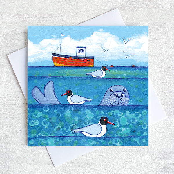 A charming greetings card from an original painting by Joanne Wishart, imaging floating on the water with these seal heads popping up above the surface to say hello!