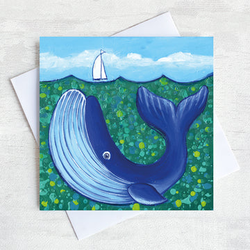 A charming greetings card from an original painting by Joanne Wishart, this joyous nautical picture features a big blue whale under a teal green sea.