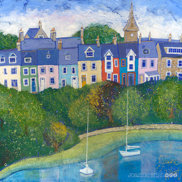 A row of colourful houses perch above the river Aln in this charming Northumberland print by local artist Joanne Wishart