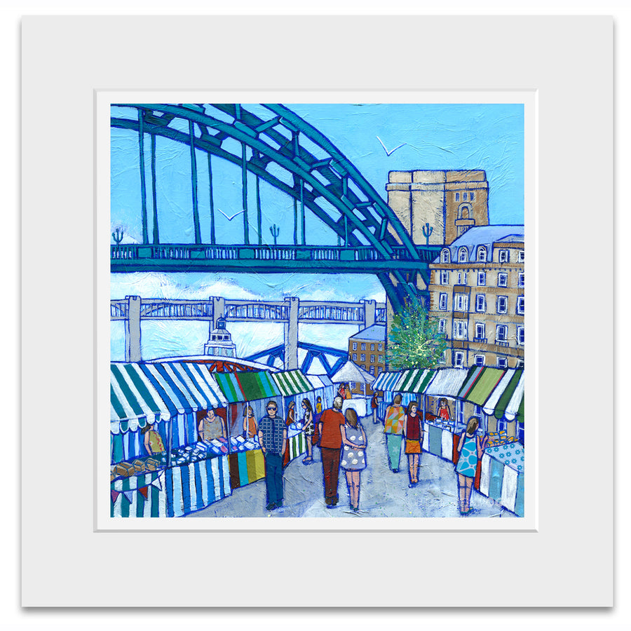 A mounted print of Newcastles Tyne bridge with the quayside market colourfully  captured underneath.