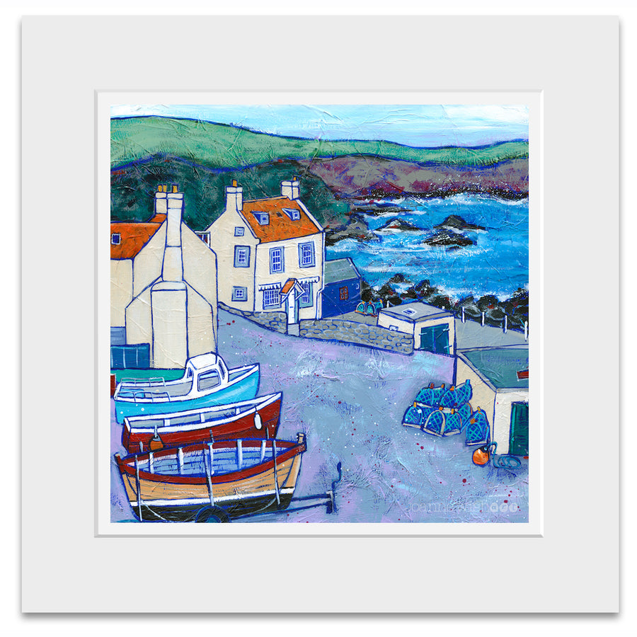 A mounted print of St Abbs cottages and fishing boats .